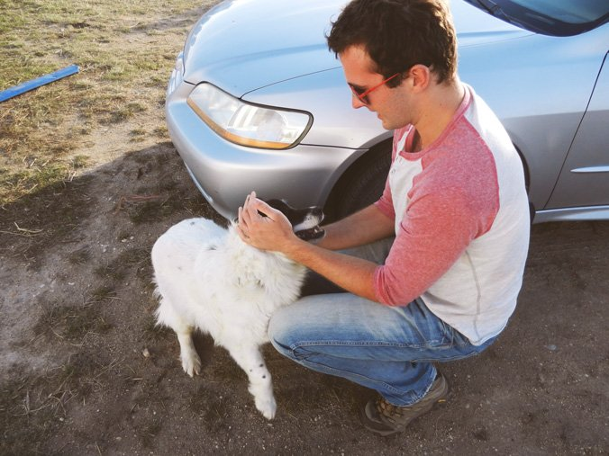 Chris is never too busy to pet his favorite dog!