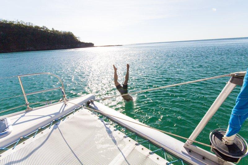 Chris Jumping From the Catamaran